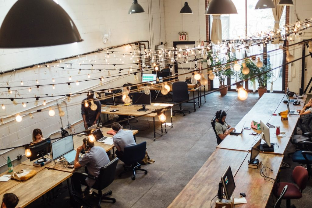 coworking space with wooden tables overhead view